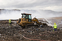 Firefighters putting out a huge fire at a landfill site in Ufton Warwickshire England. This image may only be used to portray the subject in a positive manner..©shoutpictures.com..john@shoutpictures.com