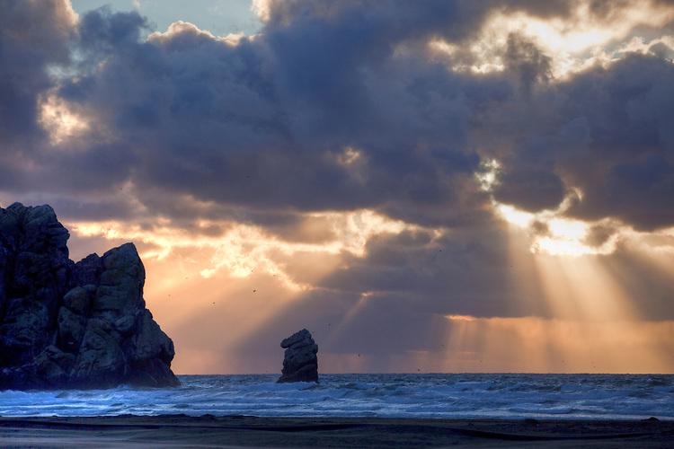 Sunburst over Morro Rock at Morro Bay on California's central coast.