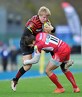 Jackson Wray is tackled in possession. Aviva Premiership match, between Saracens and London Welsh on March 3, 2013 at Allianz Park in London, England. Photo by: Patrick Khachfe / Onside Images
