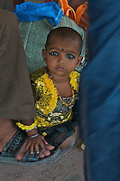 Child at the Varanasi Train Station, India