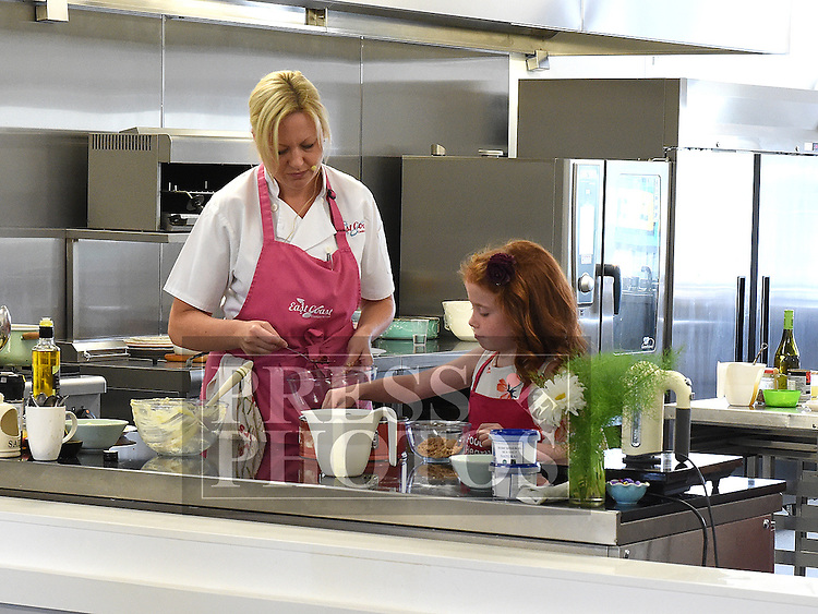 Summer Browne helps Chef Tara Walker at the cookery demonstration in the North East Food Hub at Ardee Business Park. Photo:Colin Bell/pressphotos.ie
