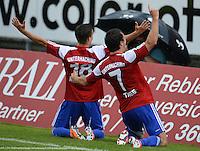3. Fussball Bundesliga:  2. Spieltag    Saison   2012/2013   SpVgg Unterhaching  - FC Hansa Rostock   28.07.2012 Jubel nach dem Tor zum 2:0 Dominik Rohracker mit Stephan Thee (v. li., Unterhaching)