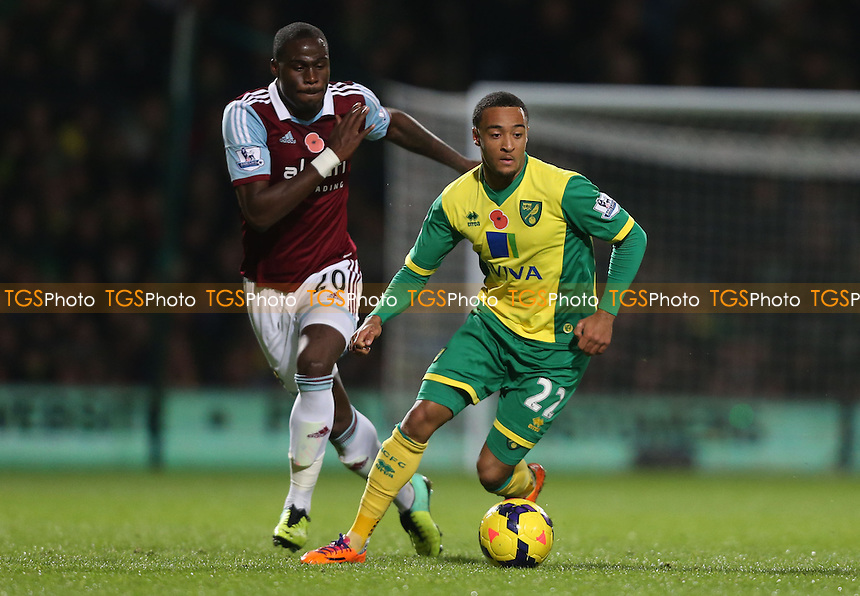 Nathan Redmond of Norwich and Guy Demel of West Ham - Norwich City vs West Ham United, Barclays Premier League at Carrow Road, Norwich - 09/11/13 - MANDATORY CREDIT: Rob Newell/TGSPHOTO - Self billing applies where appropriate - 0845 094 6026 - contact@tgsphoto.co.uk - NO UNPAID USE