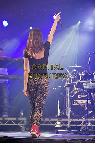 21st July 2013: UK electronic group Rudimental perform on the BBC6 Music stage on the last day of the 2013 Latitude Festival, Henham Park, Suffolk<br /> on stage in concert live gig performance performing music full length black top brown trousers back behind rear hand arm in air<br /> CAP/PP/MM<br /> &copy;Mike Mustard/PP/Capital Pictures