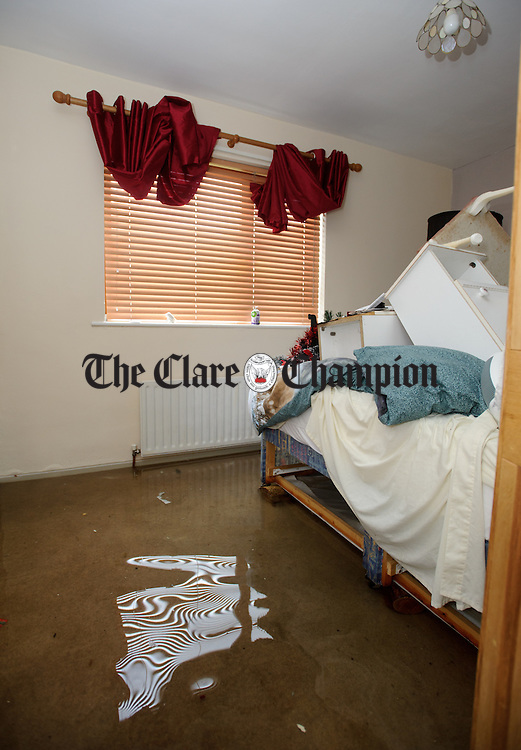 A view of a bedroom in Nancy Walsh's flooded home at Caherbroder, Gort adjacent to the M18 motorway.  Photograph by John Kelly.