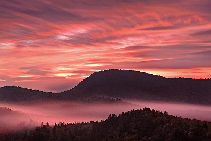 """""""MOUNTAIN DREAM"""" -- A dynamic sunset from the top of Devil's Courthouse on the Blue Ridge Parkway. Motion in the clouds and fog was captured with an 8-minute long exposure."""