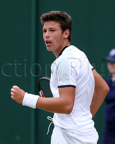 02.07.2013. Wimbledon, London England.   Wimbledon Championships 2013 AELTC London ITF Grand Slam Tennis Tournament Juniors Competition Gianluigi  ITA makes a fist to get pumped up