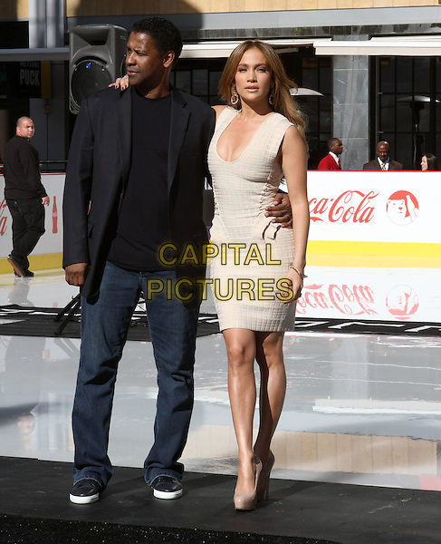 DENZEL WASHINGTON & JENNIFER LOPEZ.Jennifer Lopez Named Spokesperson for Boys & Girls Club held at The Nokia L.A Live,  Los Angeles, CA, USA, .30th November 2010..full length cleavage low dress cut sleeveless beige cream white beige patent platform nude shoes black jacket jeans arm around .CAP/ADM/KB.©Kevan Brooks/AdMedia/Capital Pictures.