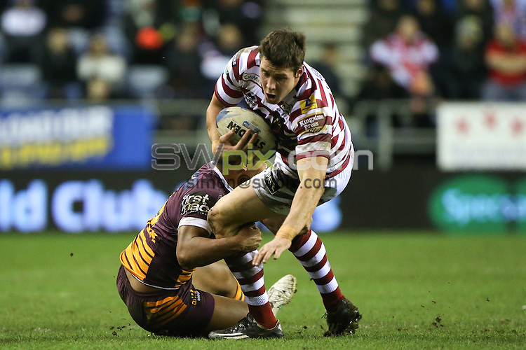 Picture by Alex Whitehead/SWpix.com - 21/02/2015 - Rugby League - World Club Series - Wigan Warriors v Brisbane Broncos - DW Stadium, Wigan, England - Wigan's Joel Tomkins is tackled by Brisbane's Anthony Milford.