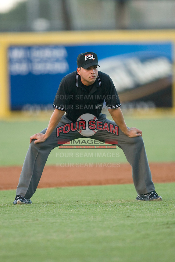 Umpire Roberto Medina handles the calls on the bases during a Florida State League game between the Charlotte Stone Crabs and the Jupiter Hammerheads at Roger Dean Stadium June 16, 2010, in Jupiter, Florida.  Photo by Brian Westerholt /  Seam Images