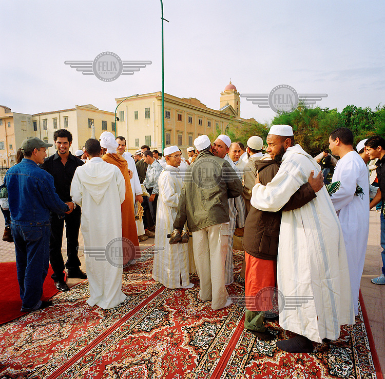 Men celebrate Eid ul-Fitr, marking the end of the holy month of Ramadan.