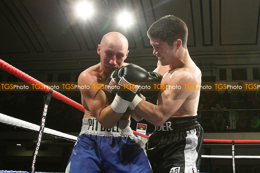 John Ryder (black shorts) defeats Mariusz Biskupski in a Middleweight boxing contest at York Hall, Bethnal Green, promoted by Matchroom Sports - 28/01/12 - MANDATORY CREDIT: Gavin Ellis/TGSPHOTO - Self billing applies where appropriate - 0845 094 6026 - contact@tgsphoto.co.uk - NO UNPAID USE.