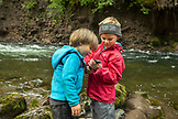 USA, Oregon, Santiam River, Brown Cannon, young boys showing off the fish they caught in the Santiam River