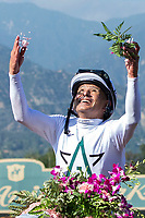 ARCADIA, CA  APRIL 7: Mike Smith throws flowers in the air after riding #6 Justify to win the Santa Anita Derby (Grade l) on April 7, 2018, at Santa Anita Park in Arcadia, Ca.  (Photo by Casey Phillips/ Eclipse Sportswire/ Getty Images)