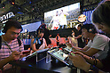 September 20, 2012, Makuhari, Japan - The Tokyo Game Show 2012 kicks off at Makuhari Messe convention center, east of Tokyo, on Thursday, September 20, 2012...More than 200 game makers from around the world showcase a record 1,043 titles in the four-day event, the biggest in the gaming industry in the world, which is expected to draw roughly 195,000 visitors with 1,609 booths open for hands-on experience of new titles and other products, according to the organizer. This year's show sees a surge in the number of game titles for smartphones, up from last year's 98 to 265, as social networking games further increase their presence.  (Photo by Natsuki Sakai/AFLO) AYF -mis-