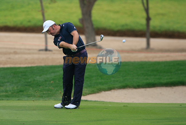 Damien McGrane plays his 2nd shot on the11th hole during Thusday Day 1 of the Abu Dhabi HSBC Golf Championship, 20th January 2011..(Picture Eoin Clarke/www.golffile.ie)