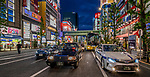Cars stopped at lights on the main street in Akihabara known as Electric Town in Tokyo, Japan