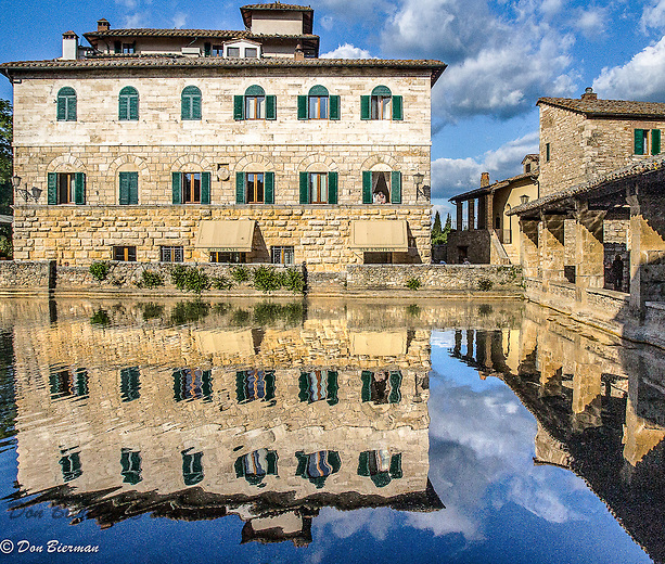 A hotel reflected in an ancient thermal pool. Montepulciano, Italy.