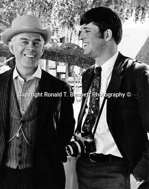 Movie actor and Ron Bennett in Hollywood California, Photojournalism, Photojournalist, News, sports, features, Hollywood, White House, &quot;Photography is art at the speed of light,&quot;<br /> Political,  &quot;Photography is art at the speed of light,&quot;<br /> collecting, editing, presenting news photographs, Photojournalism provides visual support for stories mainly in the print media,  Fine Art photography are photographs that are created to fulfill the creative vision of the photographer,