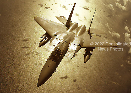 A United States Air Force F-15C aircraft from the 67th Fighter Squadron prepares to refuel in flight from a KC-135R, from the 909th Air Refueling Squadron, June 28, 2001, while on a routine training mission over the Pacific Ocean.  Both units are stationed at Kadena Air Base, Japan.  .Mandatory Credit: Marvin Krause / U.S. Air Force via CNP