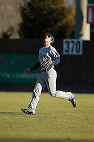 Rice Owls right fielder Charlie Warren (5) tracks a fly ball against the Charlotte 49ers at Hayes Stadium on March 6, 2015 in Charlotte, North Carolina.  The Owls defeated the 49ers 4-2.  (Brian Westerholt/Four Seam Images)
