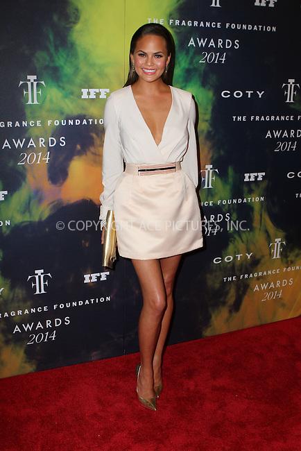 ACEPIXS.COM<br /> <br /> June 16 2014, New York City<br /> <br /> Model Chrissy Teigen arriving at the 2014 Fragrance Foundation Awards on June 16, 2014 in New York City<br /> <br /> <br /> By Line: Nancy Rivera/ACE Pictures<br /> <br /> ACE Pictures, Inc.<br /> www.acepixs.com<br /> Email: info@acepixs.com<br /> Tel: 646 769 0430