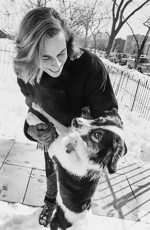 Stephanie Deutch and her dog, Francis, in her front yard, East Capitol Street, in February 1996. (Photo by Laura Patterson/CQ Roll Call via Getty Images)