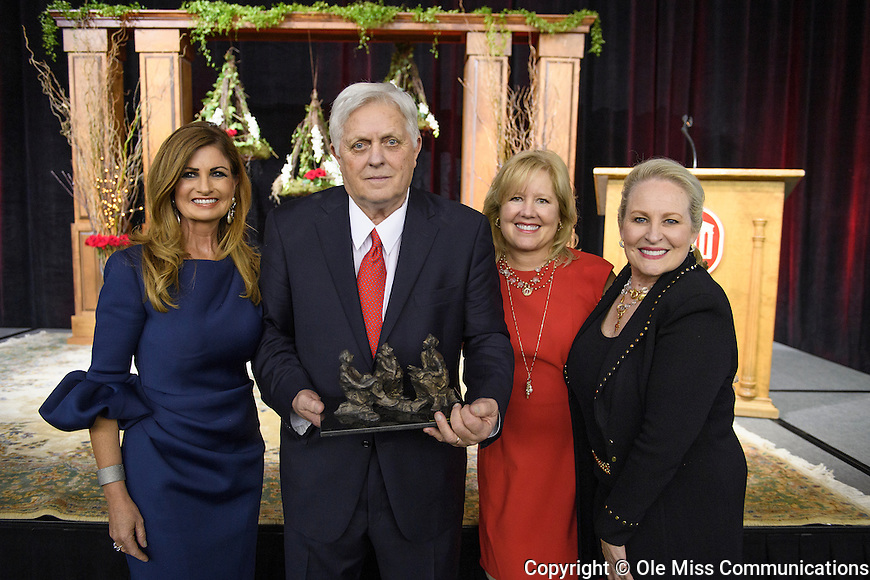 Chancellor Emeritus Robert C. Khayat poses with Mary Susan Clinton, OMWC Legacy chair; Karen Moore, OMWC chair; and Mary Haskell, OMWC incoming chair, during the Ole Miss Women's Council Legacy Awards Banquet. Khayat is the 2016 recipient of the award. Photo by Thomas Graning/Ole Miss Communications