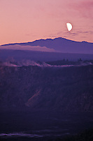 Kilauea Crater with Mauna Kea in background, taken from Crater Rim Drive,  Volcanoes National Park, Island of Hawaii. Moonrise added via double exposure.