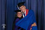 Marisa Alicea, dean of the School for New Learning, left, and Jerry T. Lange, student speaker. DePaul University School for New Learning held its commencement ceremony, Saturday, June 10, 2017, at the Rosemont Theatre in Rosemont, IL. The Rev. Dennis H. Holtschneider, C.M., president of DePaul, conferred the degrees. (DePaul University/Jeff Carrion)