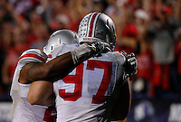 Ohio State Buckeyes defensive lineman Joey Bosa (97) gets a pat on the back from Ohio State Buckeyes linebacker Ryan Shazier (2) in the fourth quarter of their game at Ryan Field in Evanston, IL on October 5, 2013. Columbus Dispatch photo by Brooke LaValley)