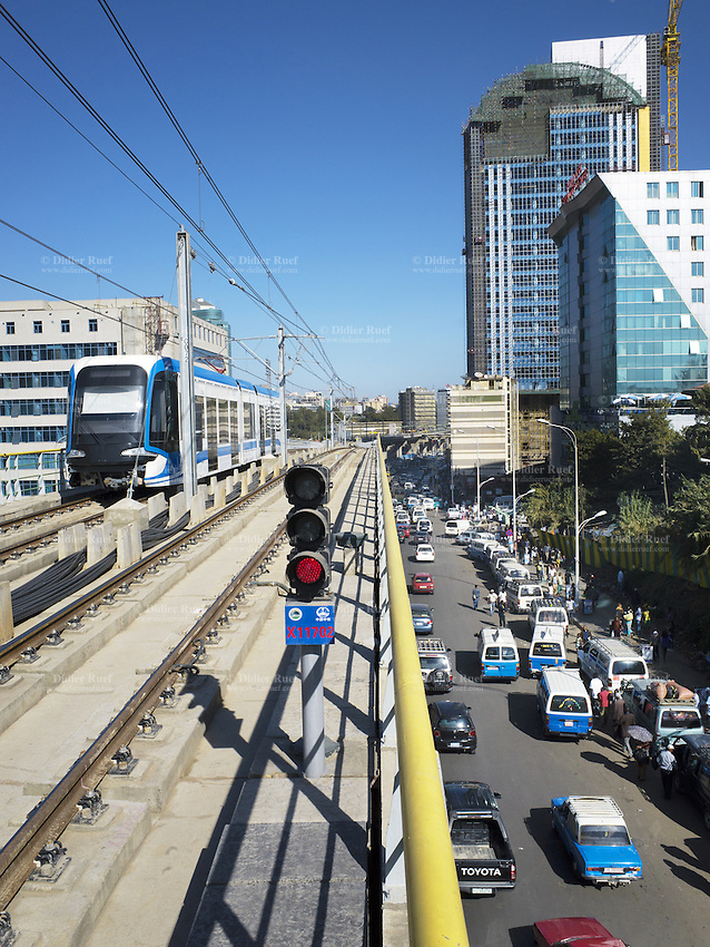 Ethiopia. Addis Ababa. A tramway enters the station. Addis Ababa Light Rail is a light rail transportation system in Addis Ababa. A 17-kilometre line running from the city centre to industrial areas in the south of the city opened on 20 September 2015. Service began on 9 November 2015 for the second line (west-east). The total length of both lines is 32 kilometres with 32 stations. Trains are expected to be able to reach maximum speeds of 70 km/h. The railway was contracted by the China Railway Group Limited and is nowdays operated by the Shenzhen Metro Group. The Ethiopian Railways Corporation began construction of the double track electrified light rail transit project in December 2011 after securing funds from the Export-Import Bank of China. This light-rail system was the first to be built in sub-saharan Africa. Addis Ababa is the capital city and the name of a region of Ethiopia. 20.11.15 © 2015 Didier Ruef