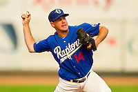 Ogden Raptors relief pitcher Jason West (14) in action against the Orem Owlz at Lindquist Field on July 29, 2012 in Ogden, Utah.  The Owlz defeated the Raptors 6-4.   (Brian Westerholt/Four Seam Images)