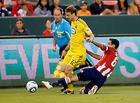 Chivas USA defender Ante Jazic (6) attempts a tackle on Columbus Crew midfielder Eddie Gaven (12). CD Chivas USA defeated the Columbus Crew 3-1 at Home Depot Center stadium in Carson, California on Saturday July 31, 2010.