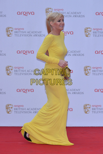 Michelle Collins.Arqiva British Academy Television Awards in 2013 at the Royal Festival Hall, London, England..12th May 2013.BAFTA BAFTAS full length yellow dress clutch bag side profile  .CAP/PL.©Phil Loftus/Capital Pictures