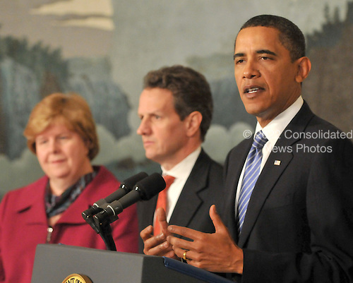 United States President Barack Obama, right, makes remarks on the financial crisis responsibility fee in the Diplomatic Reception Room at the White House in Washington, D.C. on Thursday, January 14, 2010. At left is Christina Roemer, Chairperson, Council of Economic Advisers, and at center is U.S. Secretary of the Treasury Timothy Geithner..Credit: Ron Sachs / Pool via CNP