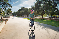 Occidental College student Ian Convy '17 rides his unicycle through the quad on Feb. 3, 2015. Ian has been riding for about three and a half years and is currently training for a round-trip ride from Oxy to Long Beach. (Photo by Marc Campos, Occidental College Staff Photographer)
