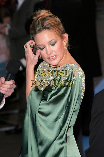 "KATE HUDSON.""Fool's Gold"" UK film premiere, Vue Leicester Square, London, England..April 10th, 2008.half length green gold silk satin patterned pattern kimono dress sleeves funny face hand eyes closed  .CAP/AH.©Adam Houghton/Capital Pictures."