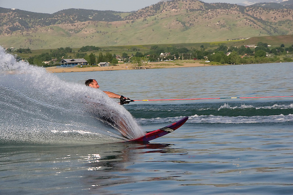 Man slalom waterskiing at Boulder Reservoir, Boulder, Colorado, USA .  John leads private photo tours in Boulder and throughout Colorado. Year-round. .  John offers private photo tours in Denver, Boulder and throughout Colorado. Year-round.