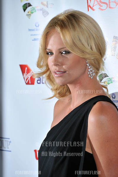 "Charlize Theron at Sir Richard Branson's ""Rock the Kasbah"" gala benefitting Virgin Unite, at the Hollywood Roosevelt Hotel..October 23, 2008  Los Angeles, CA.Picture: Paul Smith / Featureflash"