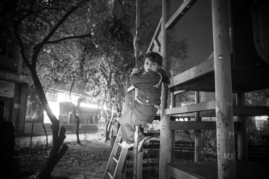 Pepita, 4, a homeless child being cared for by her young aunt plays on a playground in a Bucharest neighborhood where her relatives usually gather, some of them are drug users.