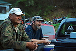 Charles Hayes (right) and Ralph Daniel Overman jr. III stood around a truck on Little Buckhorn road on Oct. 14th, laughing and discussing the local area.  .Photo by Sam Verbulecz