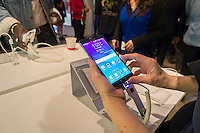 A visitor tries out the new Samsung Galaxy Note 4 in a Samsung pop-up shop in Soho in New York on the phablet's release date, Friday, October 17, 2014. Samsung released the new Galaxy Note 4 today going head to head with the Apple iPhone 6 Plus in what is being called the phablet wars. (© Richard B. Levine)