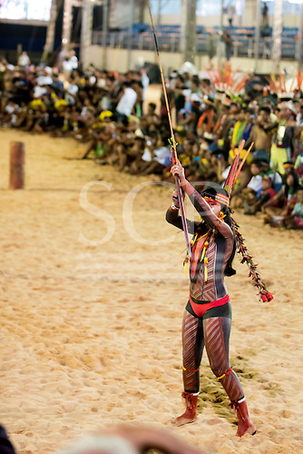 A Karaja indigenous woman wields her bow and arrow to demonstrate a different concept of beauty and strength at the International Indigenous Games, in the city of Palmas, Tocantins State, Brazil. Photo © Sue Cunningham, pictures@scphotographic.com 24th October 2015