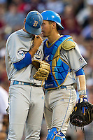 UCLA catcher Shane Zeile (14) talks with pitcher Adam Plutko (9) during Game 1 of the 2013 Men's College World Series Finals against the Mississippi State Bulldogs on June 24, 2013 at TD Ameritrade Park in Omaha, Nebraska. The Bruins defeated the Bulldogs 3-1, taking a 1-0 lead in the best of 3 series. (Andrew Woolley/Four Seam Images)