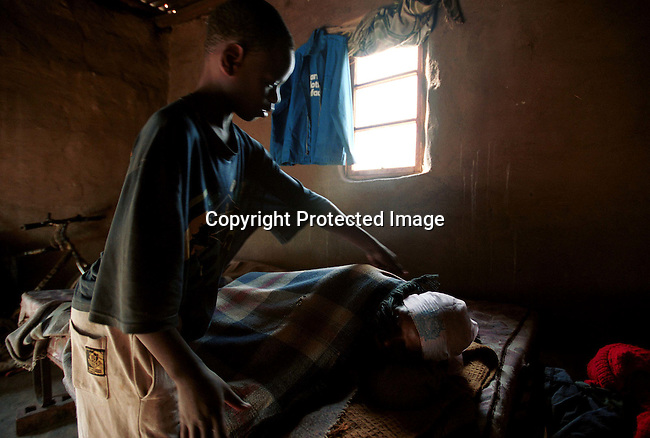 Domfikile Tibe and her son Spamale in their home on July 2, 2001 in Murchison, a rural area in Natal, South Africa. Domfikile is suffering from an Aids related disease and is mostly staying in bed. A hospice called South Coast Hospice visits patients in their homes and give them counseling and emotional support. South Africa has the highest infection rate in the world with about about 4.5 million people infected by HIV-Aids..(Photo: Per-Anders Pettersson/ iAfrika Photos)