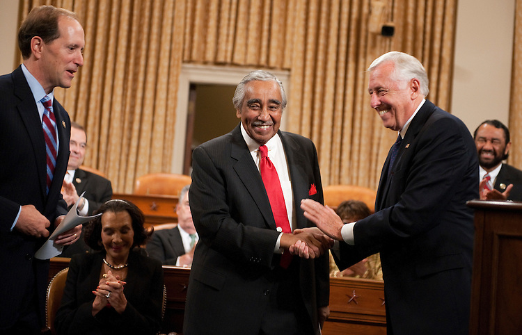 UNITED STATES - SEPTEMBER 22:  House Minority Whip Steny Hoyer, D-Md., greets Rep. Charlie Rangel, D-N.Y., as House Ways and Means Committee Chairman Dave Camp, R-Mich., left, looks on,  during a ceremony to unveil Rangel's portrait in the committee's hearing room in Longworth Building.  Rangel was chairman of the Committee from 2007-2010.  (Photo By Tom Williams/Roll Call)