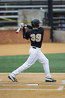 Nick Bisplinghoff (39) of the Wake Forest Demon Deacons follows through on his swing against the Towson Tigers at Wake Forest Baseball Park on March 1, 2015 in Winston-Salem, North Carolina.  The Demon Deacons defeated the Tigers 15-8.  (Brian Westerholt/Four Seam Images)