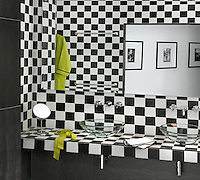 In one of the bathrooms the traditional black and white Moroccan tiles are given a contemporary twist