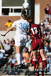 North Carolina's Elizabeth Guess (30) and Texas A&M's Paige Carmichael (13) challenge for a header on Saturday, November 25th, 2006 at Fetzer Field in Chapel Hill, North Carolina. The University of North Carolina Tarheels defeated the Texas A&M Aggies 3-2 in an NCAA Division I Women's Soccer Championship quarterfinal game.